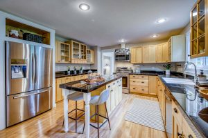 Gleaming hardwood floors throughout kitchen and home - sunny sustainable retreat